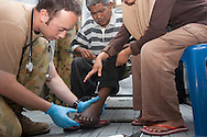 Sei Gerringging, Western Sumatra, Indonesia, 10th October 2009:?Australian medic Corporal Sean O'Regan from the 1st health Support Battalion treats a patient at an Australian Army medical clinic in Sei gerringging following a devastating earthquake in Western Sumatra that claimed the lives of an estimated 2000 people.?Photo: Joseph Feil