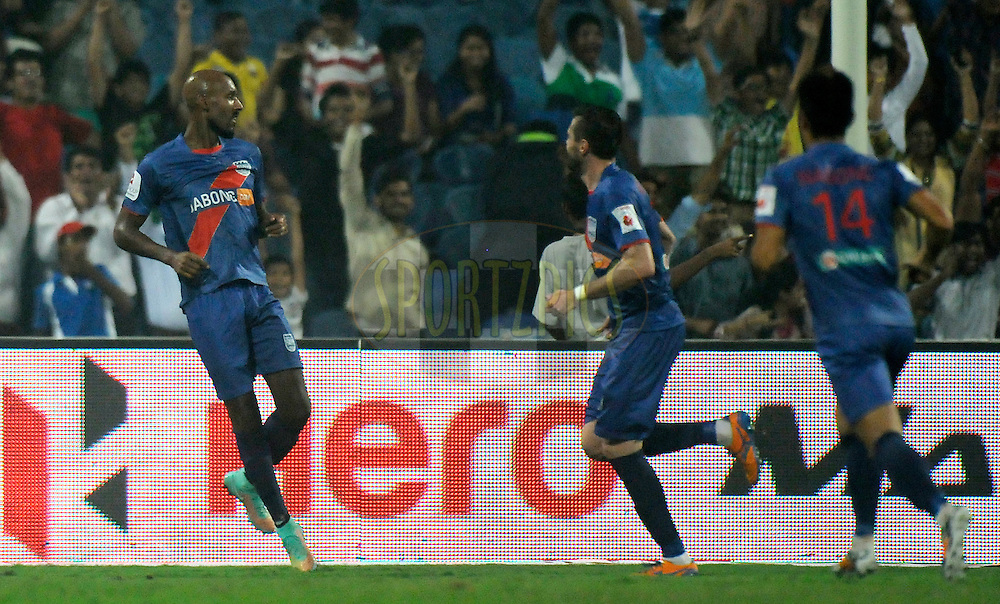 Nicolas Anelka of Mumbai City FC runs to celebrate after hitting a goal during match 22 of the Hero Indian Super League between Mumbai City FC and Delhi Dynamos FC City held at the D.Y. Patil Stadium, Navi Mumbai, India on the 5th November.<br /> <br /> Photo by:  Pal Pillai/ ISL/ SPORTZPICS