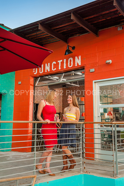 Locals Melissa Wiklinski and Kim LaViolette enjoy cocktails on the patio of The Junction