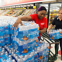Palmer's Shoppers Value Foods employee Christy Thomas, left, and night manager Serita Murphy restock bottled water at the grocery store Friday afternoon. A boil water notice was put into effect for Tupelo Water and Light customers Thursday night, and many people have been buying water bottles at local retailers like Palmer's Shoppers Value Foods.
