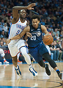 OKLAHOMA CITY, OK - FEBRUARY 26: Orlando Magic Guard Rashad Vaughn (20) driving towards the lane while Oklahoma City Thunder Forward Jerami Grant (9) plays defense at Chesapeake Energy Arena Oklahoma City, OK (Photo by Torrey Purvey/Icon Sportswire)