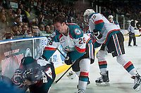 KELOWNA, CANADA - DECEMBER 30: Cole Linaker #26 of Kelowna Rockets checks Kirk Bear #4 of Prince George Cougars at the boards after losing his helmet on December 30, 2014 at Prospera Place in Kelowna, British Columbia, Canada.  (Photo by Marissa Baecker/Shoot the Breeze)  *** Local Caption *** Cole Linaker;