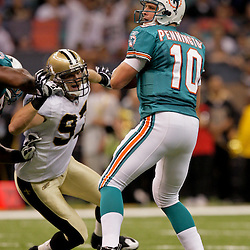 2009 September 03: Miami Dolphins quarterback Chad Pennington (10) is pressured by New Orleans Saints defensive end Jeff Charleston (97) during a preseason game between the Miami Dolphins and the New Orleans Saints at the Louisiana Superdome in New Orleans, Louisiana.