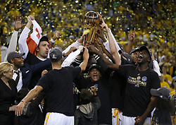 June 12, 2017 - Oakland, California, U.S.- The Golden State Warriors hold up the NBA Finals trophy after defeating the Cleveland Cavaliers, 129-120, in Game 5 of the NBA Finals at Oracle Arena. (Credit Image: © Nhat V. Meyer/TNS via ZUMA Wire)