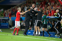 5LILLE, FRANCE - Friday, July 1, 2016: Wales' Aaron Ramsey celebrates victory with Wales manager Chris Coleman and back room staff at the end of the UEFA Euro 2016 Championship Quarter-Final match against Belgium at the Stade Pierre Mauroy. (Pic by Paul Greenwood/Propaganda)