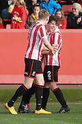 Dan Holman scores and celebrates his 4th goal during the Vanarama National League match between Cheltenham Town and Woking at Whaddon Road, Cheltenham, England on 12 March 2016. Photo by Antony Thompson.