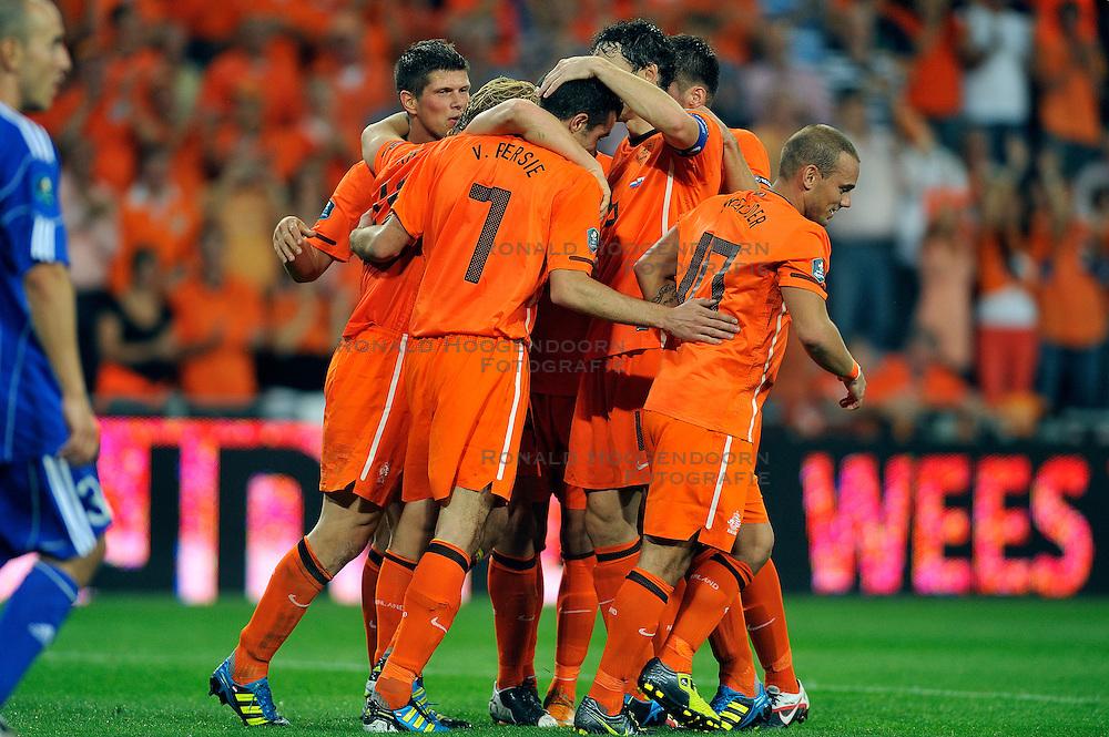 02-09-2011 VOETBAL: NEDERLAND - SAN MARINO: EINDHOVEN<br /> Nederland wint met 11-0 van San Marino / Dirk Kuyt scores the 4-0 and Klaas-Jan Huntelaar, Mark van Bommel, Wesley Sneijder<br /> &copy;2011-FotoHoogendoorn.nl