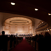 December 12, 2012 - New York, NY : Conductor Gustavo Dudamel, on pedestal, leads the  Simón Bolívar Symphony Orchestra of Venezuela as they perform Esteban Benzecry's 'Chaac (Maya Water God) from Rituales Amerindios' at Carnegie Hall's Stern Auditorium / Perelman Stage on Tuesday evening.  CREDIT: Karsten Moran for The New York Times