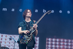 © Licensed to London News Pictures. 30/08/2015. Reading, UK. The Maccabees performing at Reading Festival 2015, Day 3 Sunday.  In this picture - Hugo White.  Photo credit: Richard Isaac/LNP