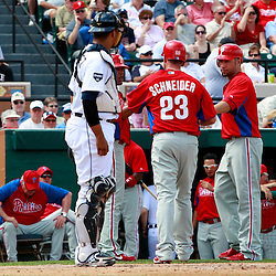 March 9, 2011; Lakeland, FL, USA; Philadelphia Phillies catcher Brian Schneider (23) is congratulated by teammates after hitting a three run homerun against the Detroit Tigers during a spring training exhibition game at Joker Marchant Stadium.   Mandatory Credit: Derick E. Hingle