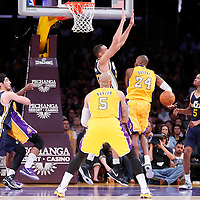 19 October 2014: Los Angeles Lakers guard Kobe Bryant (24) makes the behind the back no-look pass to Los Angeles Lakers forward Carlos Boozer (5) during the Los Angeles Lakers 98-91 victory over the Utah Jazz, in a preseason game, at the Staples Center, Los Angeles, California, USA.