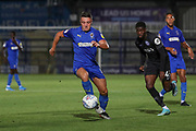 AFC Wimbledon midfielder Anthony Hartigan (8) battles for possession with Brighton and Hove Albion striker Taylor Richards (45) during the EFL Trophy (Leasing.com) match between AFC Wimbledon and U23 Brighton and Hove Albion at the Cherry Red Records Stadium, Kingston, England on 3 September 2019.
