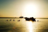 Locals enjoy the last few warm rays of sunshine as they take a later afternoon dip in the waters of Little Corn Harbor.