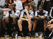 Feb. 15, 2011; Phoenix, AZ, USA; Utah Jazz forward Francisco Elson (left) , forward Gordon Hayward and forward Jeremy Evans react on the bench against the Phoenix Suns at the US Airways Center.  The Suns defeated the Jazz 102-101. Mandatory Credit: Jennifer Stewart-US PRESSWIRE