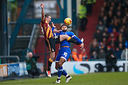 Bradford City defender Anthony McMahon (29) challenges Oldham Athletic forward Aaron Amadi-Holloway (10)  during the EFL Sky Bet League 1 match between Oldham Athletic and Bradford City at Boundary Park, Oldham, England on 28 January 2017. Photo by Simon Davies.