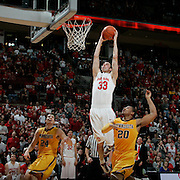 ( OSUMBB08 Carrizo  02/07/09) OSU's Jon Diebler, 33, goes for a dunk after a steal over Minnesota's Lawrance Westbrook, 20, and Blake Hoffarber, 24, during the second period of a NCAA Mens basketball game between OSU and Minnesota on Saturday, February 7, 2009 in Columbus, Ohio.(Dispatch photo by Leonardo Carrizo)