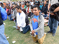 Pedro Chan kneels as he prays during the Papal Mass celebrated by Pope Francis Benjamin Franklin Parkway Sunday September 27, 2015 in Philadelphia, Pennsylvania.  (Photo By William Thomas Cain)