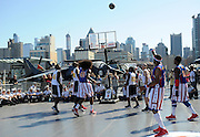 "The World Famous Harlem Globetrotters play an exhibition game on the flight deck of the Intrepid Sea, Air & Space Museum, Monday, Oct. 6, 2014, in New York, to announce the dates for their 2014-15 North American Tour.   The Globetrotters will honor a ""Hometown Hero,"" a current or past member of the U.S. armed forces, at each stop on their tour.  (Photo by Diane Bondareff/Invision for the Harlem Globetrotters/AP Images)"