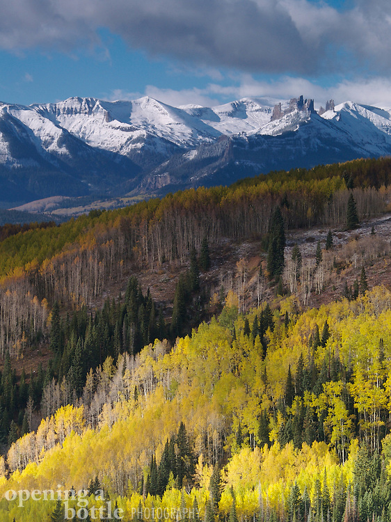 The Castles in the West Elk Wilderness Area, with aspens in full fall color, as seen from Ohio Pass near Crested Butte, Colorado.