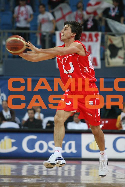 DESCRIZIONE : Pesaro Lega A1 2008-09 Scavolini Spar Pesaro Armani Jeans Milano<br /> GIOCATORE : Marco Mordente<br /> SQUADRA : Armani Jeans Milano<br /> EVENTO : Campionato Lega A1 2008-2009 <br /> GARA : Scavolini Spar Pesaro Armani Jeans Milano<br /> DATA : 12/10/2008 <br /> CATEGORIA : passaggio<br /> SPORT : Pallacanestro <br /> AUTORE : Agenzia Ciamillo-Castoria/M.Marchi