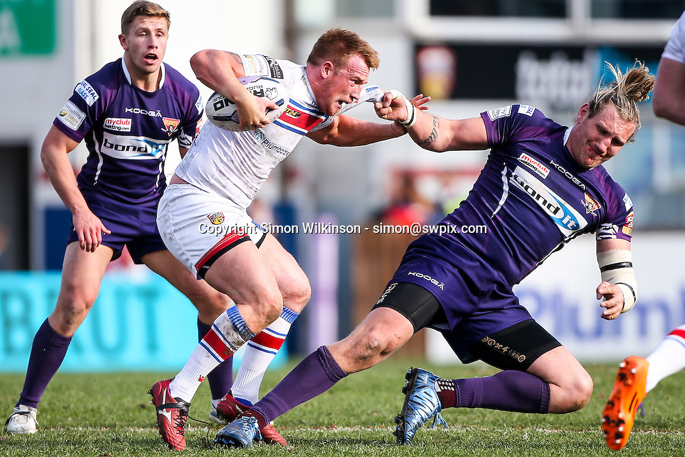 Picture by Alex Whitehead/SWpix.com - 22/03/2015 - Rugby League - First Utility Super League - Wakefield Trinity Wildcats v Huddersfield Giants - Rapid Solicitors Stadium, Wakefield, England - Wakefield's Chris Riley is tackled by Huddersfield's Eorl Crabtree.