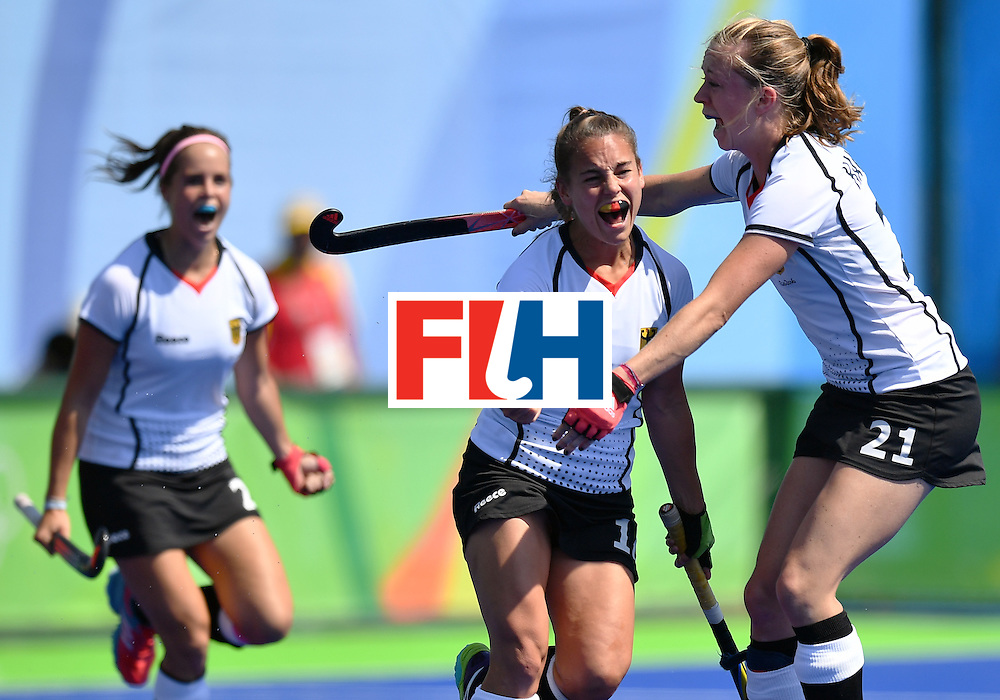 Germany's Lisa Altenburg (C) celebrates a goal during the women's quarterfinal field hockey USA vs Germany match of the Rio 2016 Olympics Games at the Olympic Hockey Centre in Rio de Janeiro on August 15, 2016. / AFP / MANAN VATSYAYANA        (Photo credit should read MANAN VATSYAYANA/AFP/Getty Images)