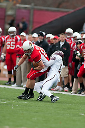 04 November 2006: Dan Passarelli gets stopped by Chris Farrar after a pass reception. In a decisive victory, the Illinois State Redbirds defeat the Missouri State Bears 38-14 at Hancock Stadium on the campus of Illinois State University in Normal Illinois.<br />