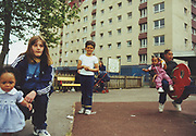 Kids in a playground outside a housing estate, Teasdale Estate, Bristol, UK, 2000's