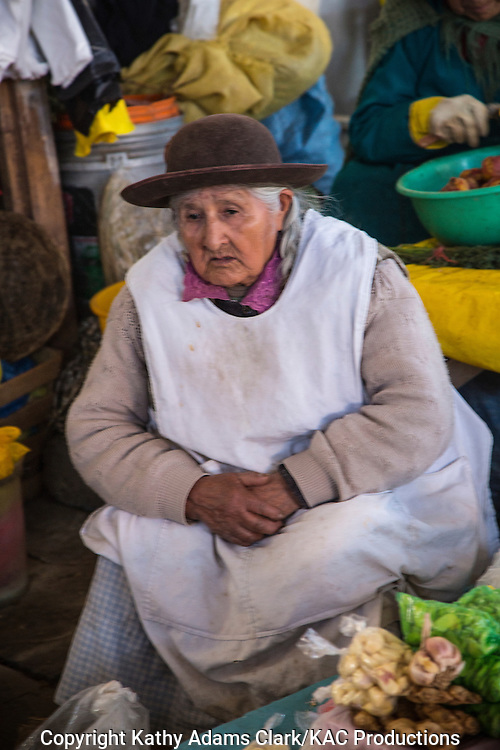 Lady in traditional dress in Cusco, Peru. Hat denotes village or region.