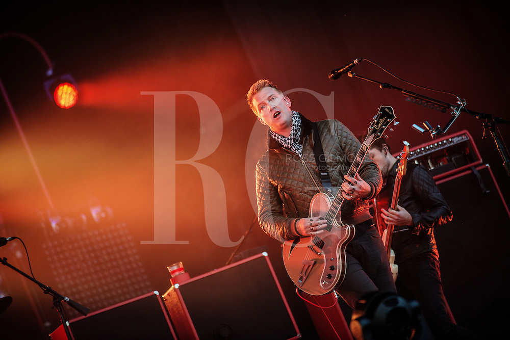 Josh Homme from Queens of the Stone Age performs on Day 2 of the Leeds Festival at Bramham Park on August 23, 2014 in Leeds, England.