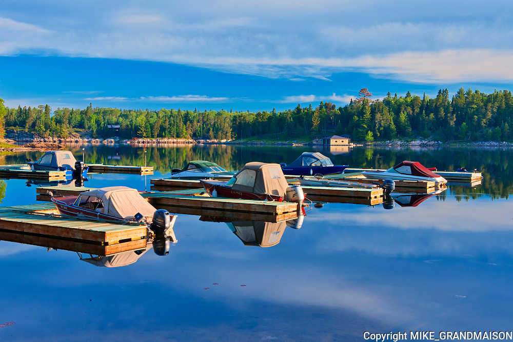 Boats in marina on the Winnipeg River<br />Kenora<br />Ontario<br />Canada
