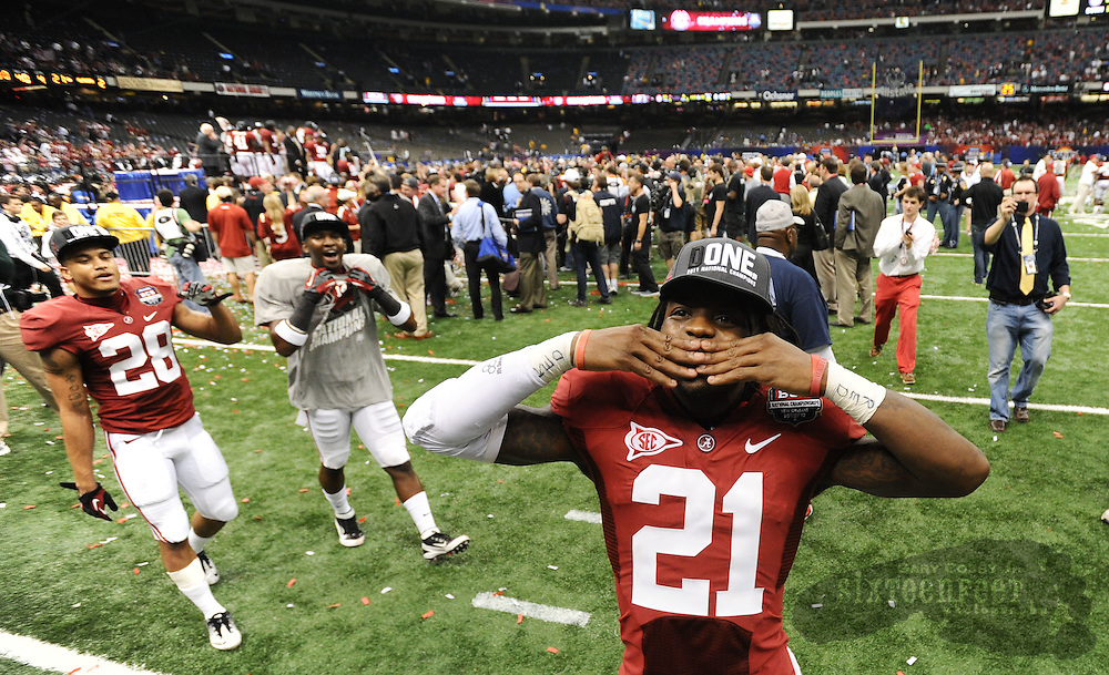 Daily Photo by Gary Cosby Jr.    ..Dre Kirkpatrick blows kisses to the crowd after Alabama defeated LSU 21-0 to claim their 14th National Championship...................................