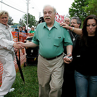 Bob Schindler (C) walks with daughter Suzanne Vitadamo (R) while greeting supporters of Terri Schiavo at the Woodside Hospice on March 23, 2005 in Pinellas Park, Fla. Photo by Scott Audette/Reuters