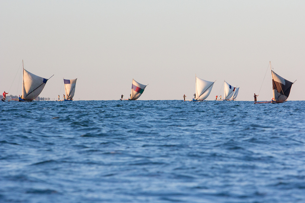 A group of traditional fishers sailing northwards on their annual migration.  The journey will take them from the protected lagoons and sheltered beaches of southwest Madagascar across exposed seas with oceanic swells; and along a coastline where the breaking surf makes it difficult to land their sailing canoes.  They use an intimate knowledge of the coast, winds and currents to navigate - often beyond the sight of land and at night.