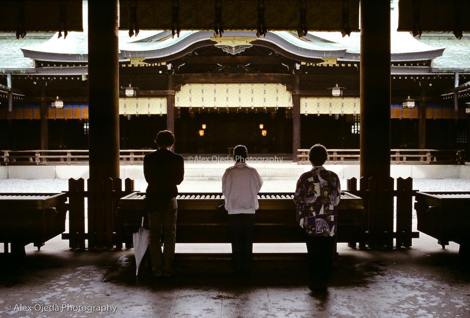 Women praying in Temple, Japan
