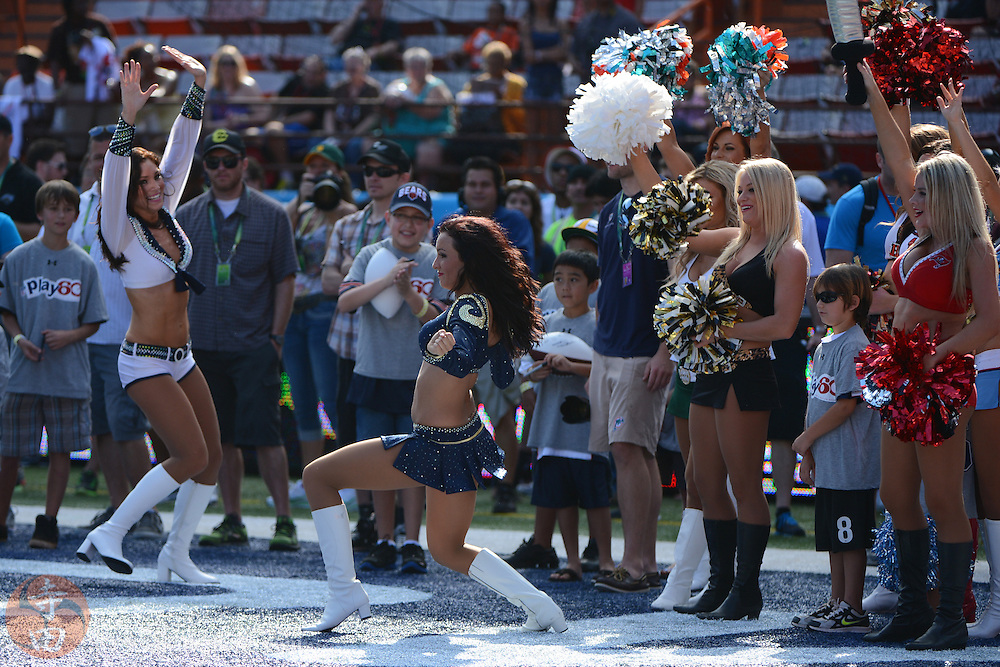 January 26, 2013; Honolulu, HI, USA; St. Louis Rams cheerleader Michelle Love celebrates after scoring a touchdown in a cheerleader and mascot football scrimmage during the AFC practice on Ohana Day at the 2013 Pro Bowl.