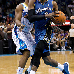 February 1, 2011; New Orleans, LA, USA; Washington Wizards point guard John Wall (2) drives past New Orleans Hornets point guard Chris Paul (3)  during the fourth quarter at the New Orleans Arena. The Hornets defeated the Wizards 97-89.  Mandatory Credit: Derick E. Hingle