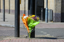 © Licensed to London News Pictures. 12/05/2019. London, UK. Flower tributes near Tollington Road, Islington in north London as Met police launch an investigation into the death of a man who was found in a wheelie bin behind a Waitrose store shortly before 4pm on Saturday 11 May 2019. Photo credit: Dinendra Haria/LNP