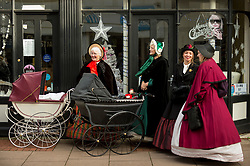 © Licensed to London News Pictures. 02/12/2018. ROCHESTER, UK.  Participants take part in the annual Dickensian Christmas Festival in Rochester.  The Kent town is given a Victorian makeover to celebrate the life of the writer Charles Dickens (who spent much of his life there), with Victorian themed street entertainment, costumed parades and a Christmas market.  Photo credit: Stephen Chung/LNP