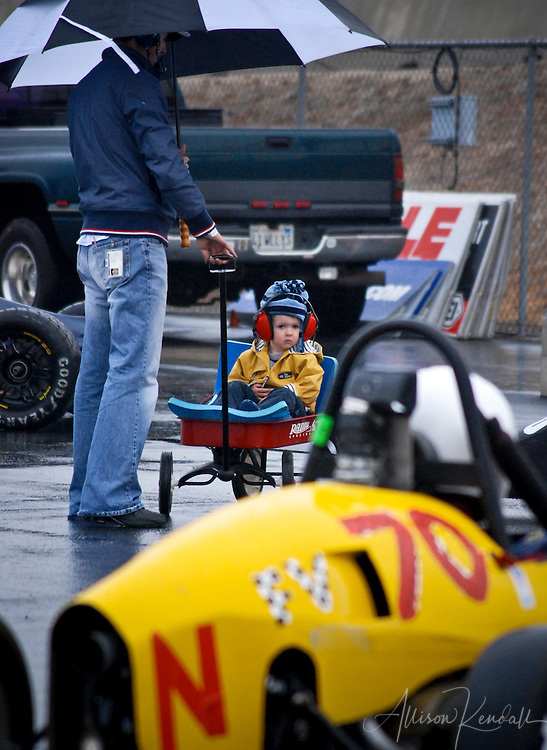 A young fan watches the race-prep activity during an SCCA event at Laguna Seca