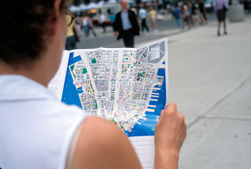 Tourist looking at a map of downtown Manhattan New York City.