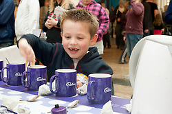 "Cadburys Spots vs Stripes Challenge Race Season Meadowhall Sheffield.Birthday Boy Ross Bingam takes part in the ""Fastest Tea Maker"" Challenge on his 7th Birthday.2 April 2011.Images © Paul David Drabble"