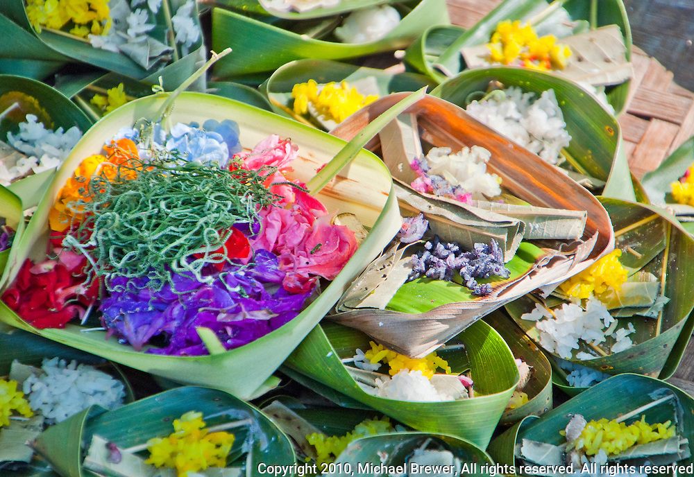 Ceremonial offerings at a funeral in Jimbaran Beach, Bali, Indonesia