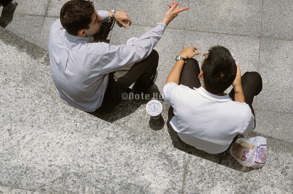 two young office people during lunch break