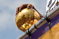 21 June 2010: Kobe Bryant of the Los Angeles Lakers holds the Larry O'Brien NBA Championship Trophy during the Lakers Championship Victory Parade on Figueroa BL. in Los Angeles, CA after the Lakers won the 2010 NBA Championship over the Boston Celtics in Game 7 of the NBA Finals.