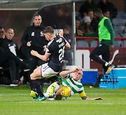 20th September 2017, Dens Park, Dundee, Scotland; Scottish League Cup Quarter-final, Dundee v Celtic; Dundee's Lewis Spence is tackled by Celtic's Scott Brown