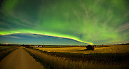 Photo Randy Vanderveen.near Buffalo Lakes east of LaGlace, Alberta.The northern lights dancing across the night sky frame a combine parked for the night in a field east of Buffalo Lakes. Harvest is underway across the Prairies.