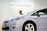 Akio Toyoda, Executive Vice President of Toyota Motor Corp., alights from the company's third generation Prius hybrid car during an unveiling of the vehicle at the automaker's showroom  was in Tokyo, Japan on 18 May 2009.