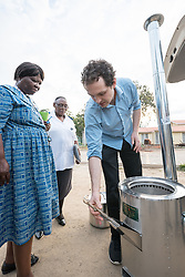 "2 March 2017, Morija, Maseru district, Lesotho: Adam Creighton, development director of InStove donates a 20-litre stove autoclave system to Scott Hospital clinical manager Ella Ramatla. The stove is to be used at the Materiel Health Centre in the district of Mafeteng, Lesotho, at a satellite learning centre run by Scott Hospital. The stove autoclave system can be used either to sterilize medical equipment, including waste, or as a cookstove. It runs on small amounts of renewable biomass. The rationale is that small pieces of biomass can be used as fuel more sustainably than when stoves require large-piece firewood. Scott Hospital is run by the Lesotho Evangelical Church in Southern Africa and is a founding member of the Christian Health Association of Lesotho. It is located in the village of Morija, and operates and supervises clinics in the Maseru District of Lesotho. Scott started out as a dispensary in 1864, and today offers comprehensive healthcare Mondays-Fridays, as well as pharmaceutical services around the clock. Lesotho suffers from high numbers in Tuberculosis in disesase and mortality, and so the hospital screens all patients for TB. The hospital observes among many patients what they describe as ""low health-seeking behaviour"", services are increasing and demand rising, but space and human resources are a challenge, as is funding. I key concern is one of infrastructure, where the original design of the hospital matches poorly with current needs, as departments and buildings are scattered, posing a challenge for security. Another challenge is to adapt donation structures, so as to be able to receive payments electronically. The hospital has one ambulance, which they describe as not enough, but what they have. Another challenge is that lack of funds affects maintenance of buildings and infrastructure, as the immediate care of patients take priority. PLEASE NOTE: This photo is not to be used in social media."