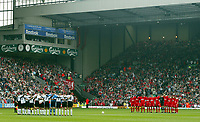 Liverpool and Fulham's players and fans stand to observe a moments slience in memory of the 96 victims of the Hillsborough disaster 14 years ago on April 15th before the Premiership match at Anfield, Liverpool, Saturday, April 12th, 2003.<br />